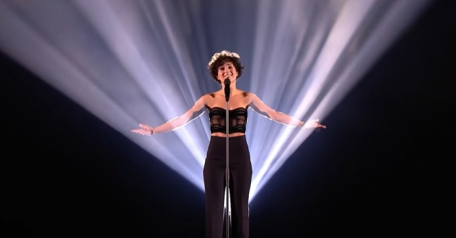 Barbara Pravi sings on stage at Eurovision 2021. Fans celebrate France's highest-ever score at Eurovision