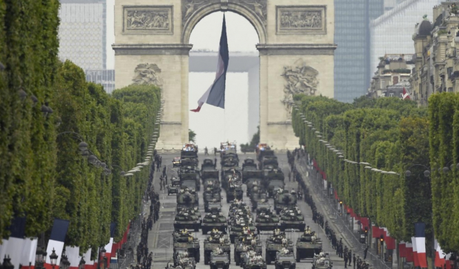 Tanks travel down the Champs-Elysees. Military parade but no fireworks: How France is celebrating July 14