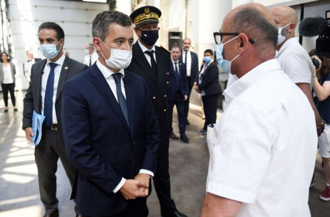 Mr Darmanin meets officials while wearing a white mask.  Bayonne bus driver death: French minister plans new measures