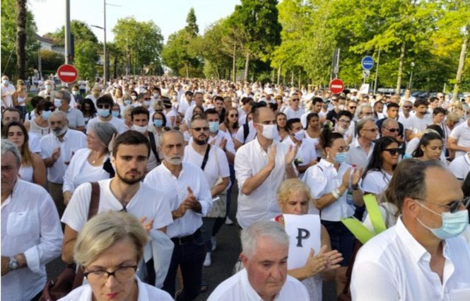 Thousands of people march in white in Bayonne. Wife of brain dead bus driver in Bayonne: 'I will fight'