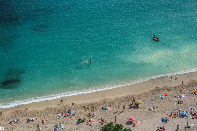 A beach with sunbathers in France. French police ask topless sunbather to cover up