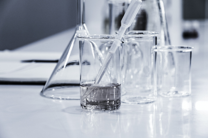 Three beakers and a pipette with clear liquid. There has been a minimal rise in Covid-19 traces found in Paris water