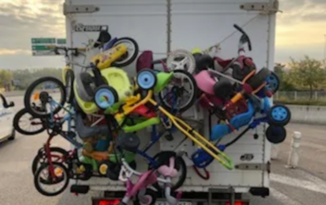 The van loaded with bikes on the road. Gendarmerie stop five tonne van overloaded with bikes in south France