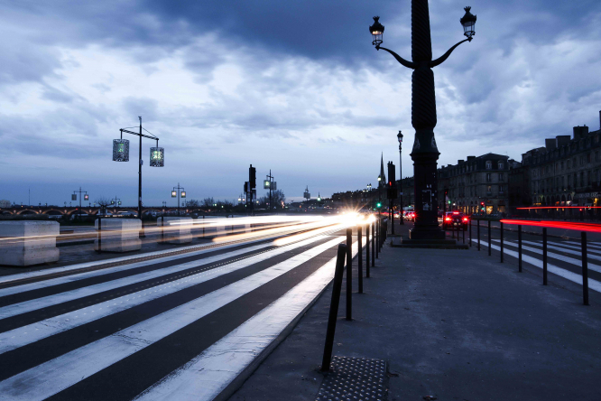 Place de la Bourse in Bordeaux in the evening, with lights from cars. The new mayor has revealed he would like make Bordeaux car-free