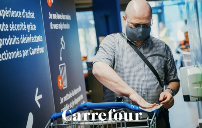 A man using a disinfectant tunnel. New supermarket 'disinfection cabins' in France: FAQs