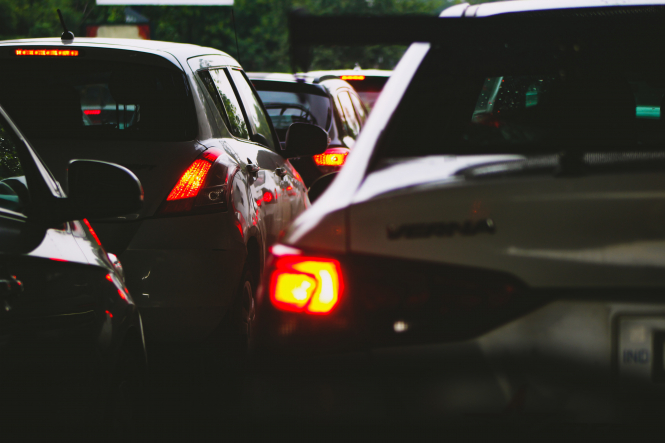 Taillights of cars waiting in traffic. As borders between France and Italy reopened, drivers were faced with long waits to cross the border into France.