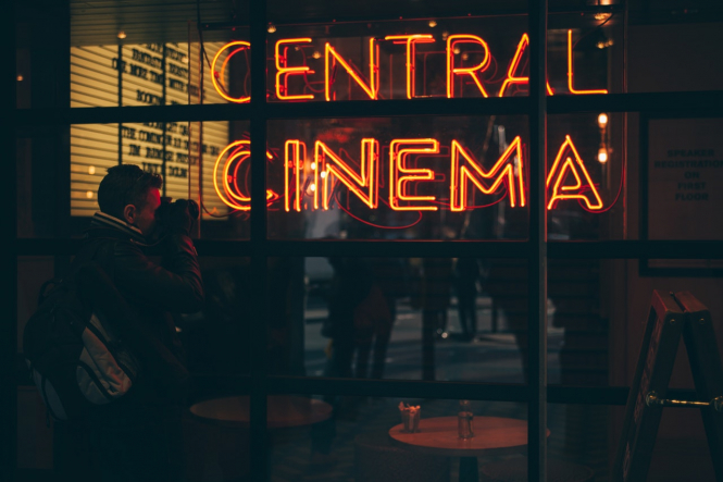 A cinema lit up at night. France curfew: More details on plans to fight 'second wave'