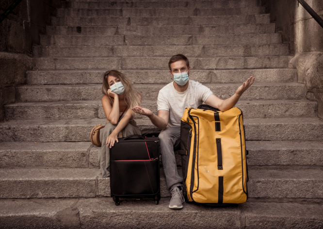 Confused travellers with masks to protect against Covid-19