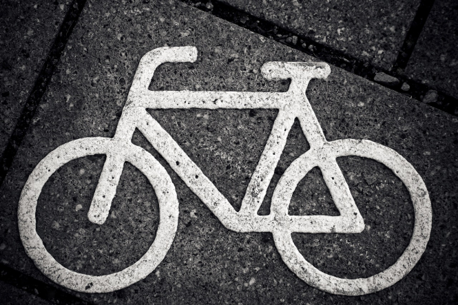 The cycling symbol on the ground. France lockdown: Can I cycle bike to the shops 10k away?