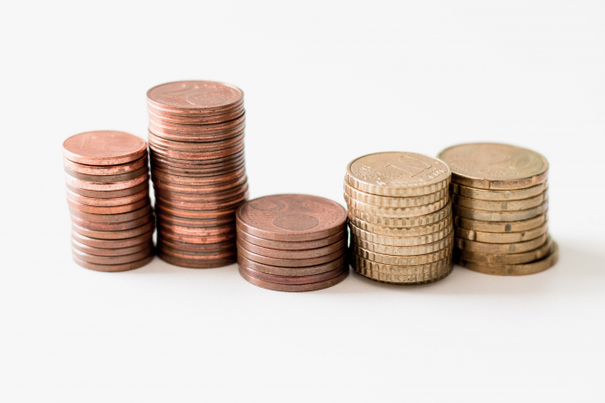 Piles of euro cents. Article: Do small businesses in France still have to accept cash payments? Photo by Ibrahim Rifath / Unsplash