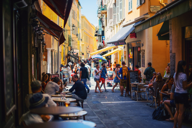 Tourists take a stroll around downtown Nice