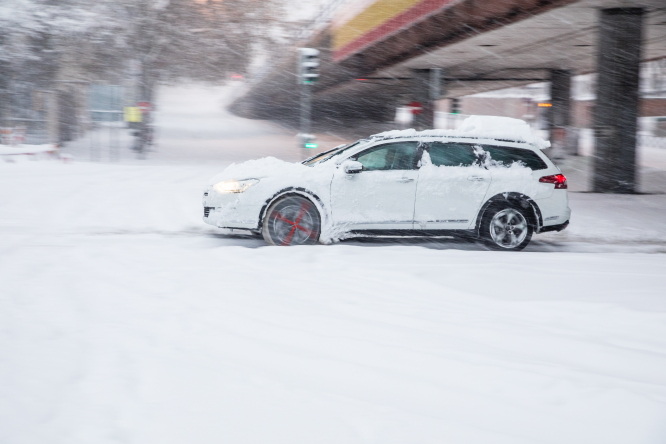 Car driving through snow. Lorry ban on motorways due to icy conditions in west France