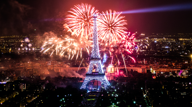 Fireworks explode over a sparking Eiffel Tower in Paris. What will France's July 14 celebrations look like this year?