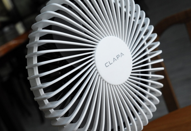 A white plastic table fan. Covid-19 summer in France: Are fans and air con safe to use?
