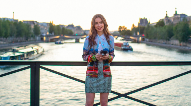Emily in Paris on bridge over the Seine. Emily in Paris cast release video to mark start of season 2 filming