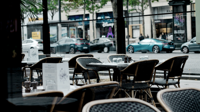 Empty chairs in a restaurant. Restaurants must reopen for lunch in March say French MPs