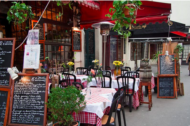 Empty tables in a restaurant on Rue Mouffetard in Paris. Covid-19: Paris bars and restaurants risk closure