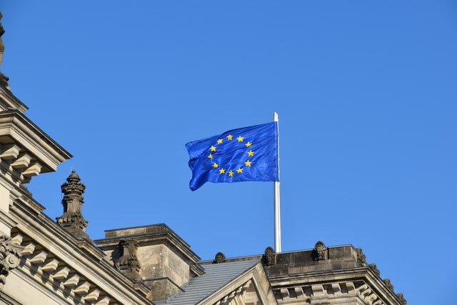 A European flag on a building. The EU has opened external borders to some countries today, but not the US.