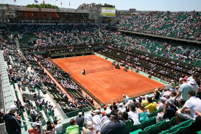 Fans waiting for a match at Roland Garros. Roland Garros tennis fans can break curfew, Paris party-goers cannot