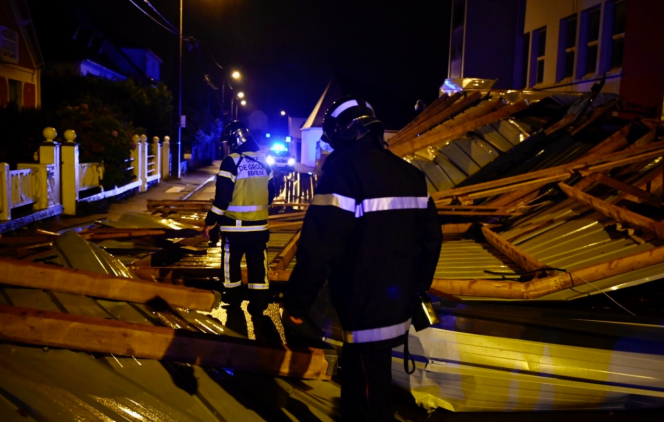 Firefighters attend a callout after Storm Alex causes destruction in Morbihan. Southeast France on red alert as Storm Alex wreaks havoc