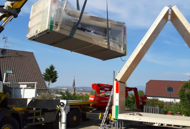 Flat-pack home being constructed. France's first low-cost 'flat pack' wooden house under construction