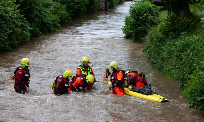 Emergency services continue to search for the missing boy in the Therain river. Mini-tornado rips off roof and one still missing as more extreme weather hits France