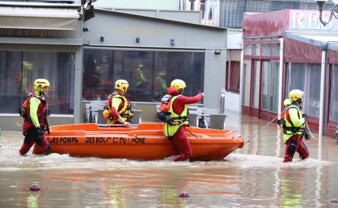 Emergency services in inflatable boats as flooding hits. VIDEOS: One missing as flash floods batter south of France