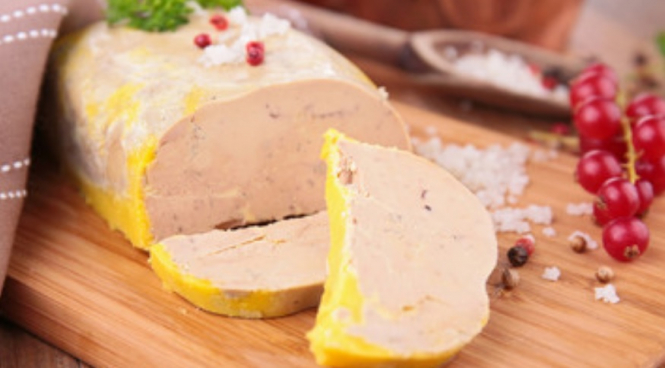 Slices of foie gras on a table. Foie gras sold at super-low prices in France in law loophole