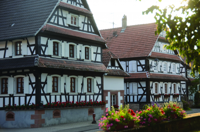 The side of a timber-framed 18th century house in Hunspach, France.