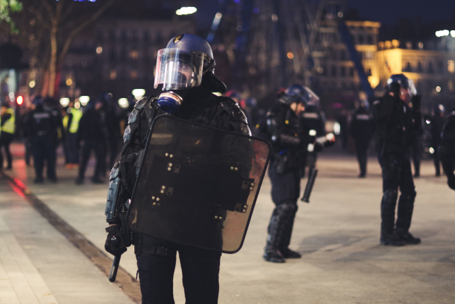 A French policeman in riot gear. Nabila Ramdani argues that social media polices the police and there's nothing France can do