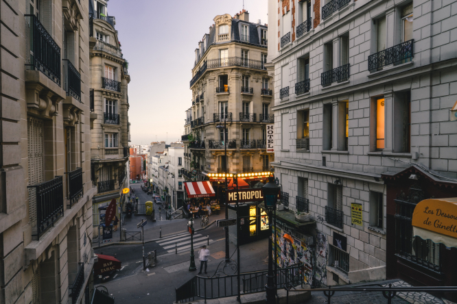 Montmartre in Paris at dusk. Article: France looks back to post-war years for tips on moving forward post-COVID-19. Photo by JOHN TOWNER / Unsplash