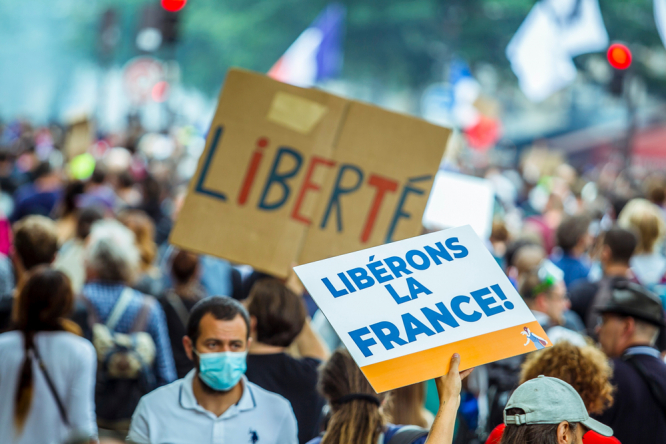 Thousands of people protest in Paris against the Covid health pass, with placards reading Liberons la France and Liberte. 141,000 march against health pass in France on eighth protest weekend