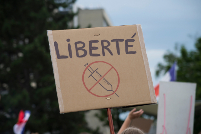 people protesting in the street against the health pass. Third weekend of protests in France against health pass rules