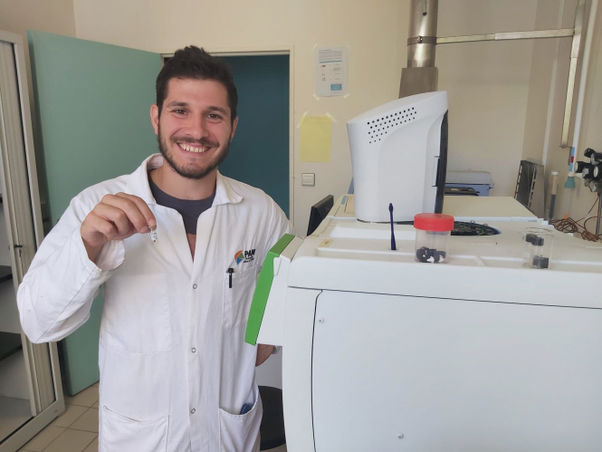 French researcher Maxime Haure by a machine that uses leftover pulp from winemaking to extract new flavours and tastes. Photo from Connexion September print edition.