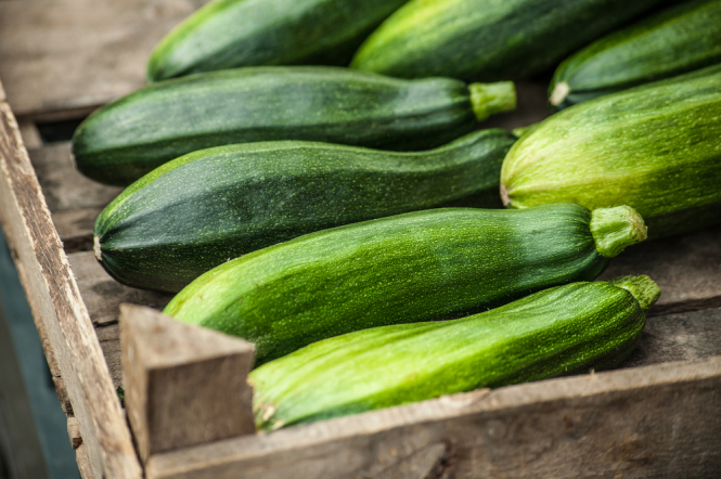 Courgettes in a wooden box. Wholesaler accused of relabelling tonnes of Spanish veg as French