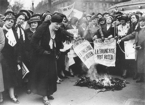 Black and white image of women protesting to demand vote