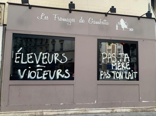 The graffiti on the windows at the Fromagerie de Gambetta. Cheese shop in Paris vandalised by militant vegan activists