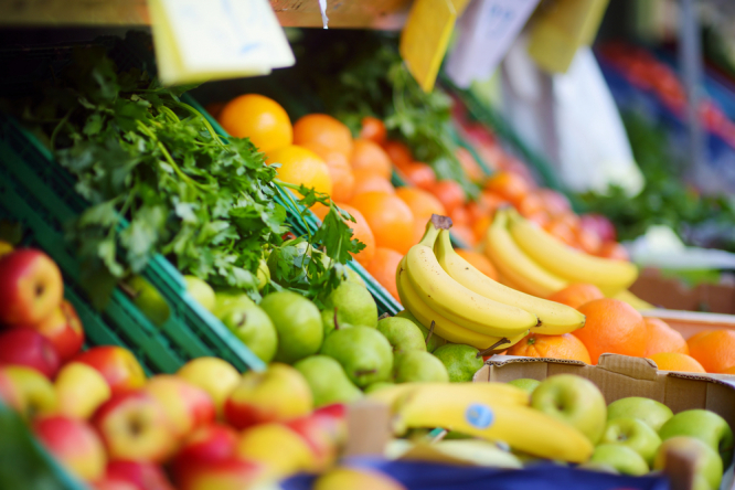 Fruit and vegetables in shop. Price of fruit and vegetables falls by 8% in France, melons down 21%
