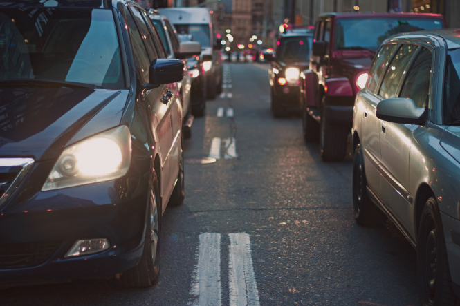 Gap between lanes of cars in traffic. French ban on motorbike lane filtering under review