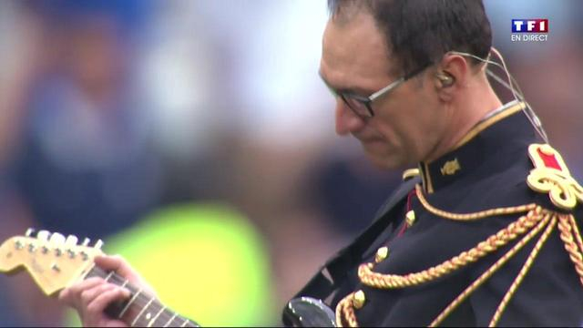 soldier plays electric guitar
