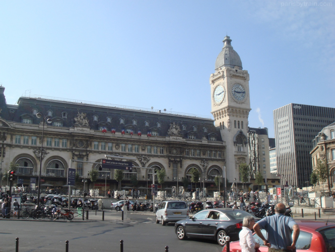 Blue sky with a large building with tall clock tower