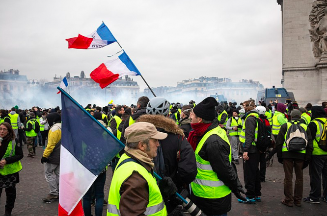 Gilets jaunes protesters near the Arc de Triomphe. Gilets Jaunes return: Protests planned for Saturday