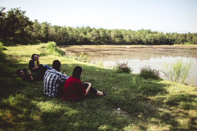 Group sitting by the water. Six questions on the semi-lockdown starting across France Saturday