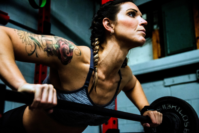 A woman lifts weights in a gym. Gyms and sports halls are now closed again in some cities and departments badly affected by coronavirus.