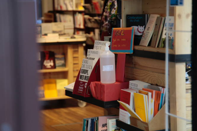 Hand gel in Paris bookshop. France lockdown: 'No decision' yet on reopening shops