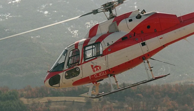 A SAF helicopter flying. Five killed in French Alps mountain rescue helicopter crash