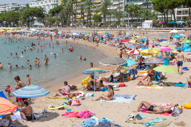 People on the beach in Cannes. France can expect soaring temperatures this weekend August 13 to 15