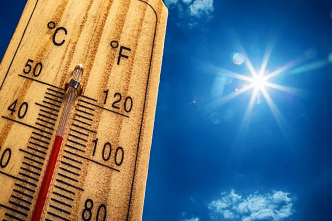 A thermometer shows high temperatures in hot sun. France on heatwave alert and water limits as drought worsens