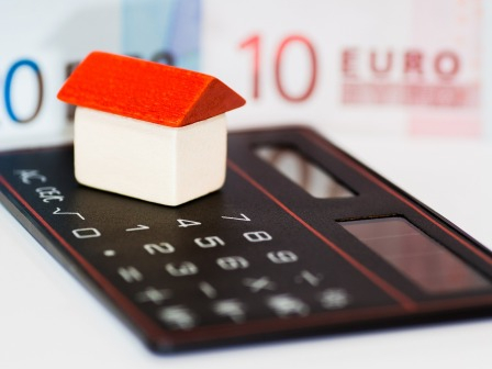 A model house and a calculator. How to claim a grant for energy upgrades in your French home with MaPrimeRenov