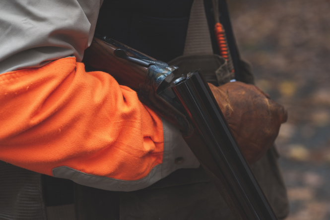 A hunter reloading a gun. Hunter given 2-year sentence for death in southeast France
